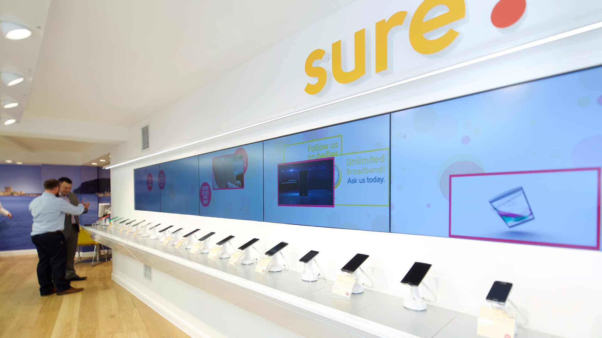 Channel Islands-based telecom company Sure International deployed a Matrox C-Series-powered signage video wall in one of its stores in St. Helier, Jersey.