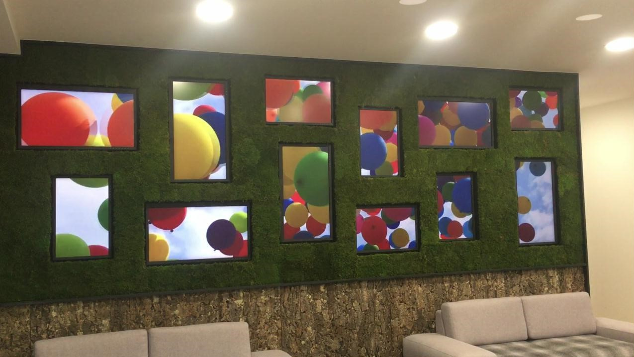 Matrox video wall technology-powered artistic video wall in EIZO's UK head office entices visitors and employees alike.