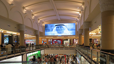 The 9x6 wall hangs high in the atrium of the mall, with its content easily visible to all passers-by.