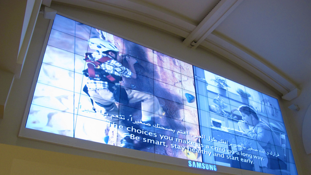 Matrox Mura MPX Series controller boards drive a 54-monitor digital signage video wall in the Mall of the Emirates.
