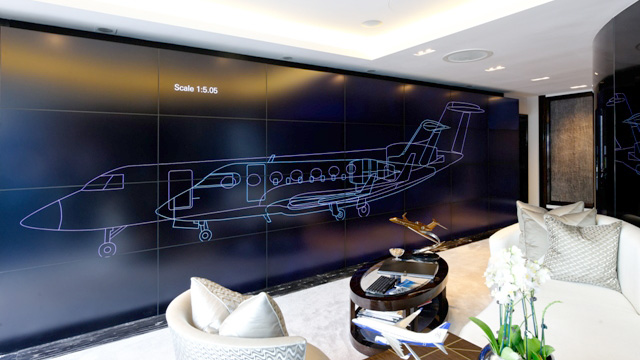 Using the app, clients can compare the sizes and shapes of available jets on the video wall by superimposing the outline of one aircraft on top of another.
