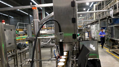 The production line as it scans cans for MFD and EXP codes.