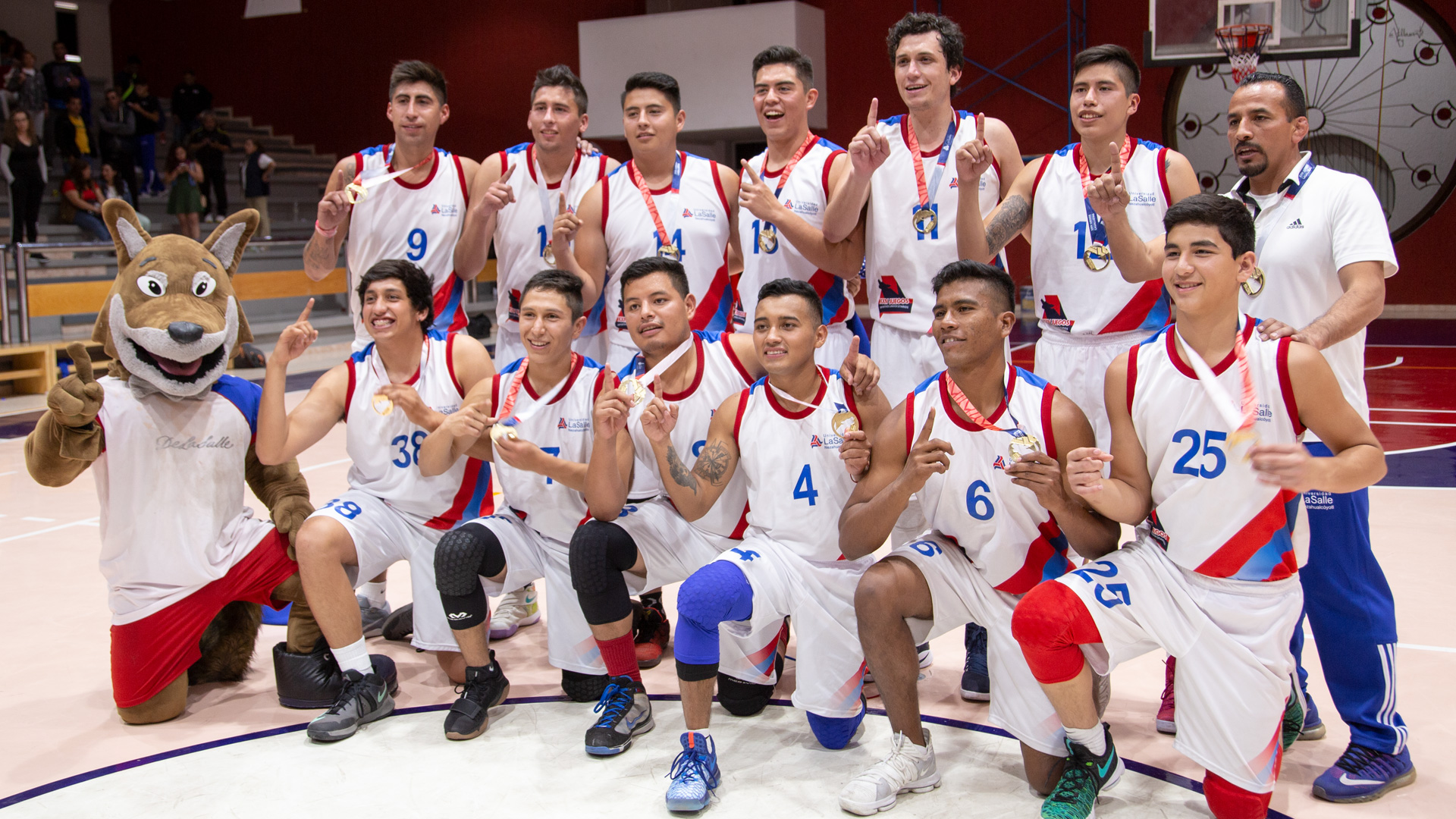 Team celebrates basketball championship win at Universidad La Salle's National Sports Games.